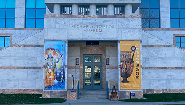 exterior photo of Carlos Museum with banners