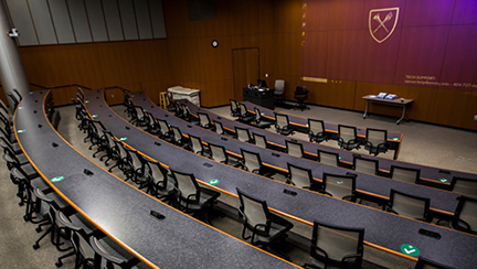 lecture classroom with social distancing decals on desk
