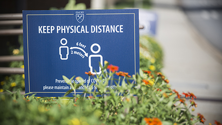 sign with physical distancing policy outdoors